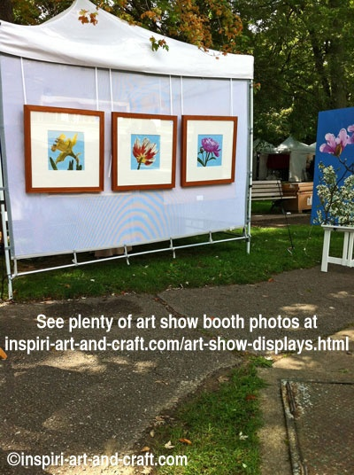 More than 25 art show booth photos at http://www.craftprofessional.com/art-show-displays.html