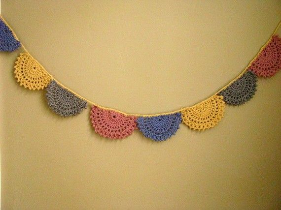 Crochet bunting with spirograph design.