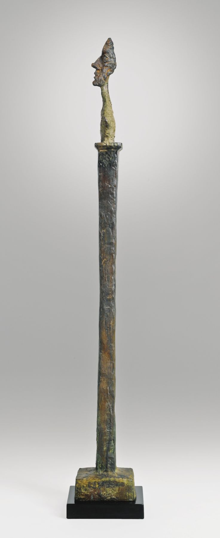 Alberto Giacometti 1901 - 1966. DIEGO SUR STÈLE II. Painted bronze Height: 165.7 cm. Conceived in 1957-58 and cast in 1958. Sotheby's, THE COLLECTION OF A. ALFRED TAUBMAN
