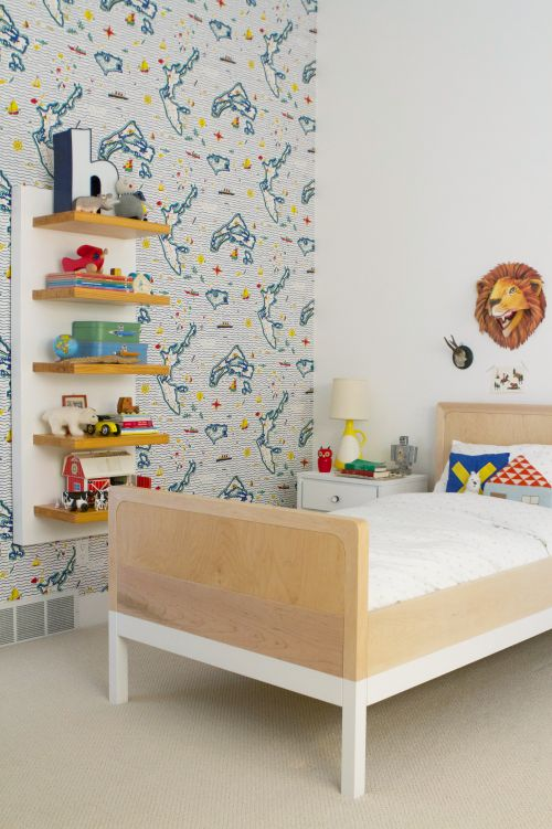 one wallpapered wall, functional and stylish shelves, simple toddler bed, and a cute stuffed lion over the bed   Living With Kids: Meta Coleman