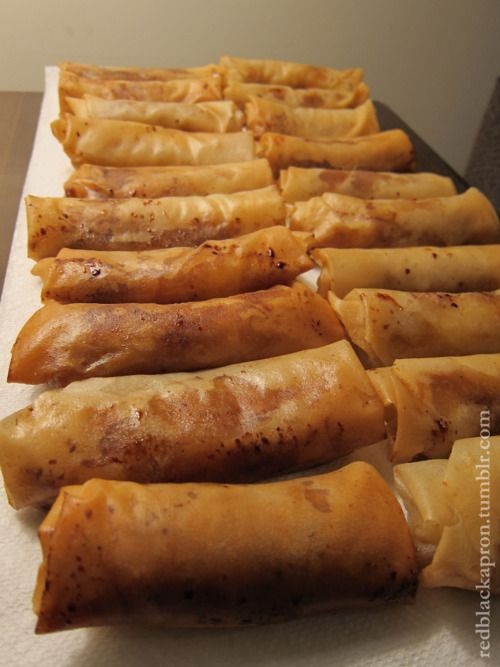 TURON (FILIPINO BANANA SPRING ROLLS) Ripe bananas Spring roll wrapper Dark brown sugar Water, for sealing the spring roll wrapper Oil, for frying