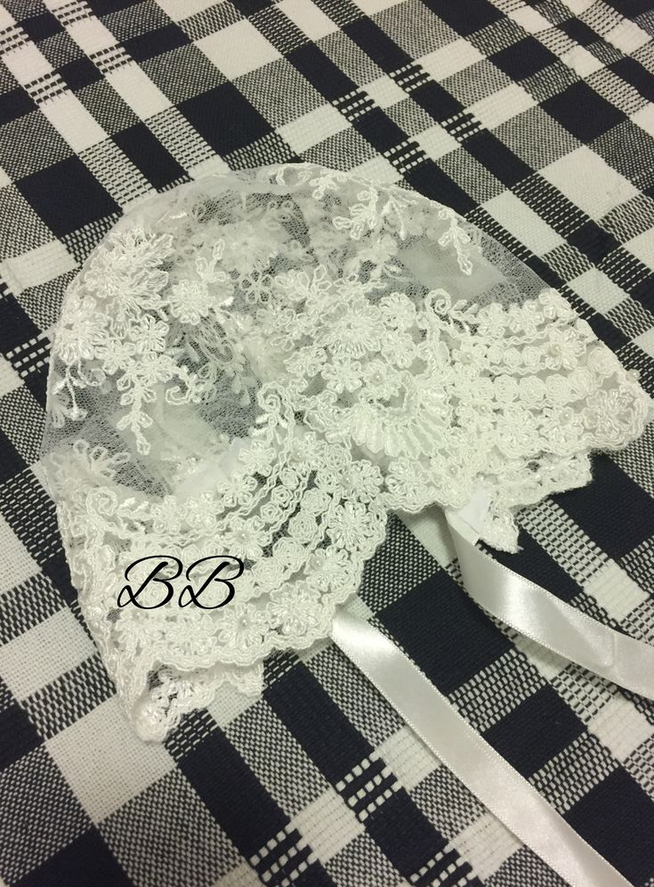 Stunning handmade lace baby bonnet with satin ribbon ties (Front) | Bisou Baby #babybonnet #handmadelacebonnet #christeningoutfit #christeningbaby #bisoubaby