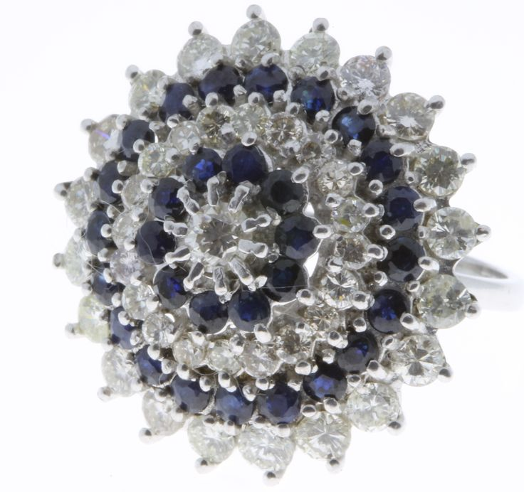 Lot 544, An 18ct white gold diamond and sapphire target ring, size M, est  £250-350