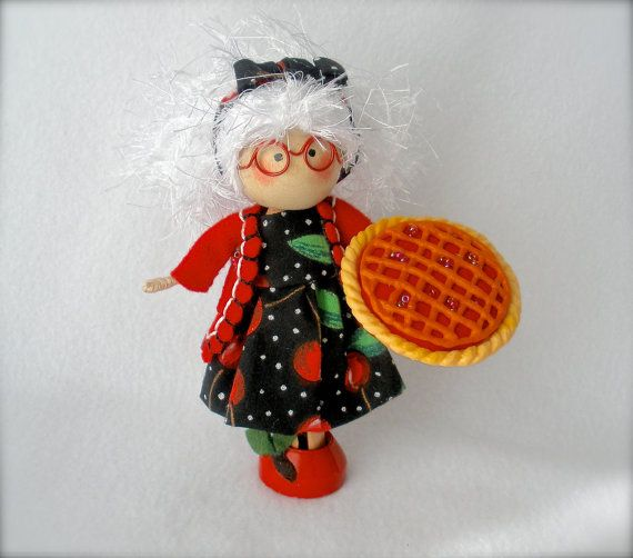 """Clothespin Doll Granny Doll Art Doll by HeartStringsHandmade This feisty grandmother clothespin doll was inspired by a poem written by Edgar Guest in 1935 called """"Cherry Pie,"""" which you may read in its entirety at the end of this listing. The last line, """"As I wend my way to Heaven, I'll be full of cherry pie"""" is her motto."""