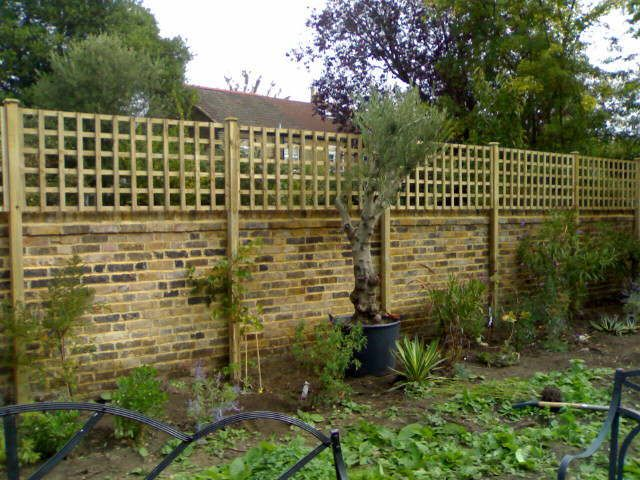 Elegant Alternative Fence Idea   Combination Brick And Wood To Make A Very Tall  Privacy Fence