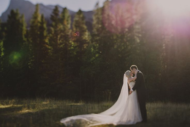Canmore sunset bride and groom portrait. Destination wedding photography by Abby Plus Dave.