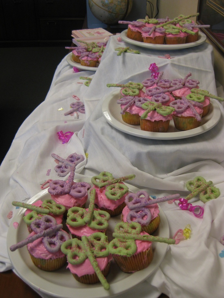 Candy-coated pretzel dragonfly cupcakes for a baby shower.