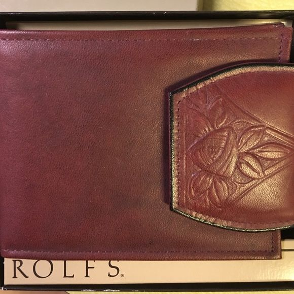 Rolfs wallet Brand new, still in box, woman's trifold burgundy wallet. From a nonsmoking home. Rolfs Bags Wallets