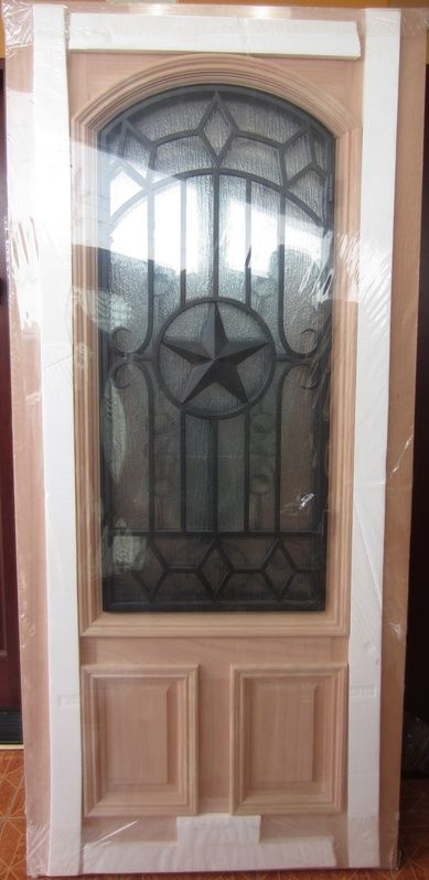 Iron Grille Texas Star Mahogany Wood Front Door.......... gorgeous in a darker color