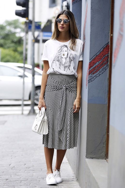 Photo via: Anna Fasano Take a break from your jeans like Anna and try a long tie-front skirt for the weekend to change things up. This easy statement piece is a