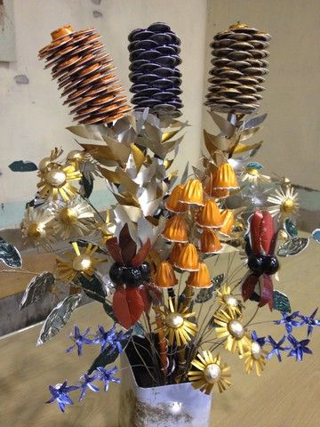 The finished piece!  A bouquet of Australian wild flowers made entirely from recycled Nespresso coffee pods.