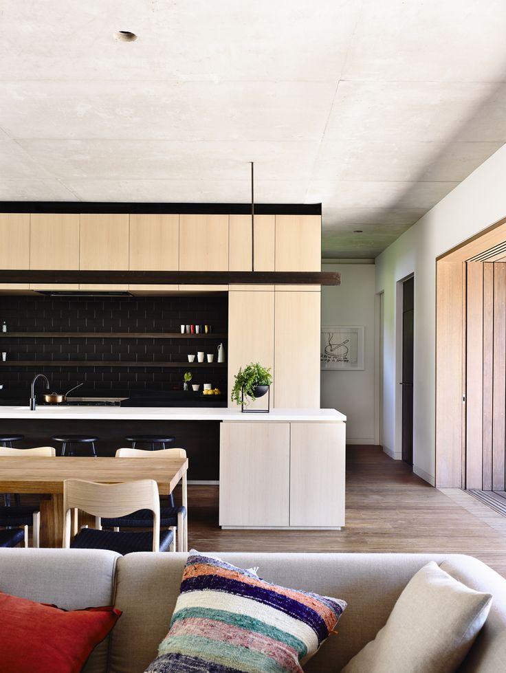 dark kitchen splashback with open shelving
