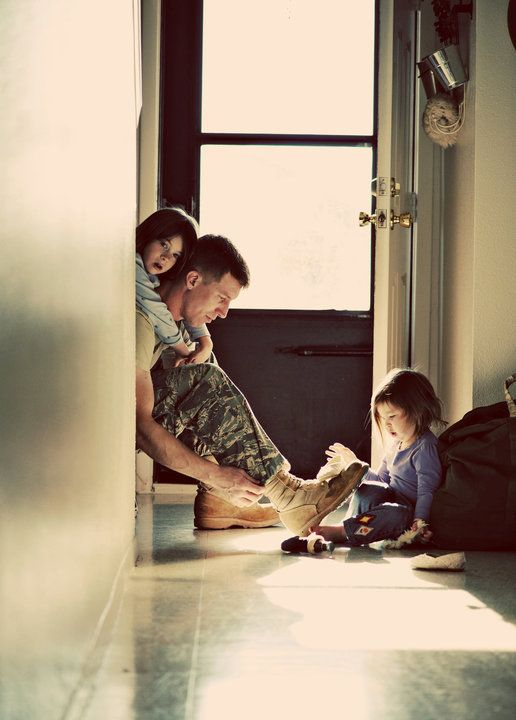 This is too cute.. I miss seeing my daughters hanging all over my husband when he gets home from work.......Photo by Andrea Hubbard.
