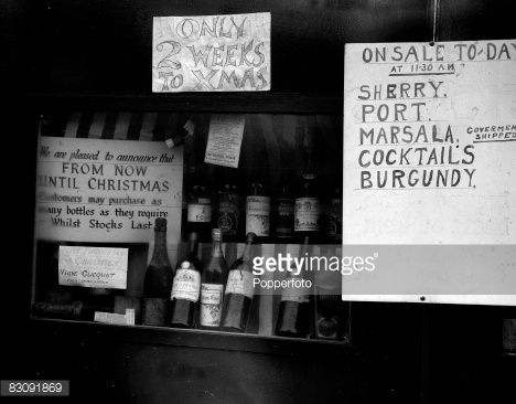 Shop window of a London wines and spirits store which was advertising cut price drink, 12th December 1944
