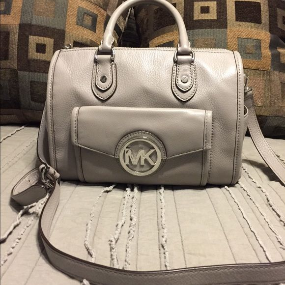 """Michael Kors bag Used a few times... Soft light gray leather and is authentic. I purchased new at the Michael Kors store Legends mall. Some light scuffing on emblem, see pic... It's not noticeable to the naked eye, have to look really close. No stains, tears or issues otherwise. Measures 11""""x9"""". Reasonable offers only will be considered. Low ball will automatically be declined, thank you. Michael Kors Bags Totes"""