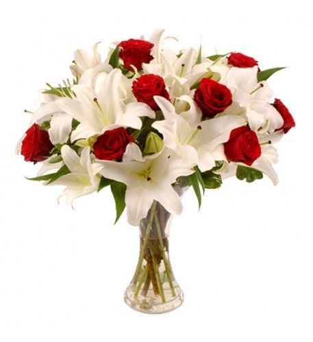 This is stylish bouquet is bursting with scented white lilies and red roses.