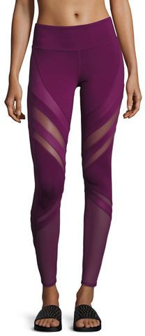 Love the violet purple color of these yoga pants! Mesh panels flatter your legs and vent excess heat in these stretchy workout leggings made with chafe-free flatlock seams.