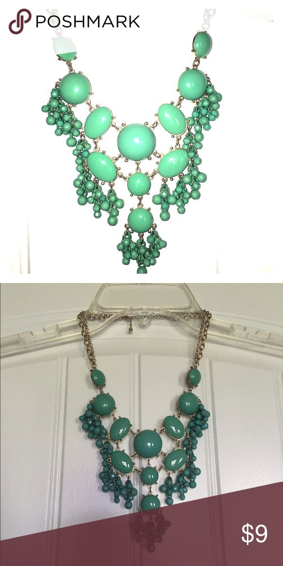 Turquoise Bubble Necklace Turquoise / teal bubble necklace with a beaded fringe look. In perfect condition! First pic is with flash and second is without. Jewelry Necklaces