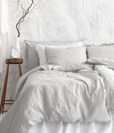 Bedroom- soft grey bedding.