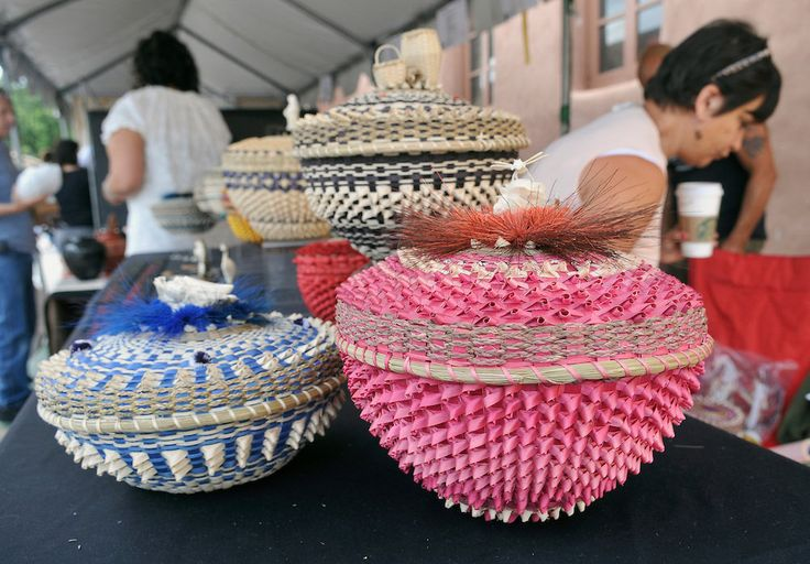 Ronni-Leigh Goeman, Onondaga, baskets on display at the Santa Fe Indian Market in Santa Fe, NM Saturday, August 20, 2011. The baskets are made from black ash, sweet grass, moose hair and porcupine quills. (Eddie Moore/Albuquerque Journal)