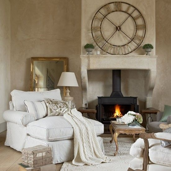 Mix generous armchairs with classic occasional chairs in the living room. Prop up gilt-framed mirrors against the wall for an informal feel and pull the whole scheme together with a textured rug. Use a giant clock to make a focal point above the mantelpiece and choose cushions with a hint of gold for added glamor.