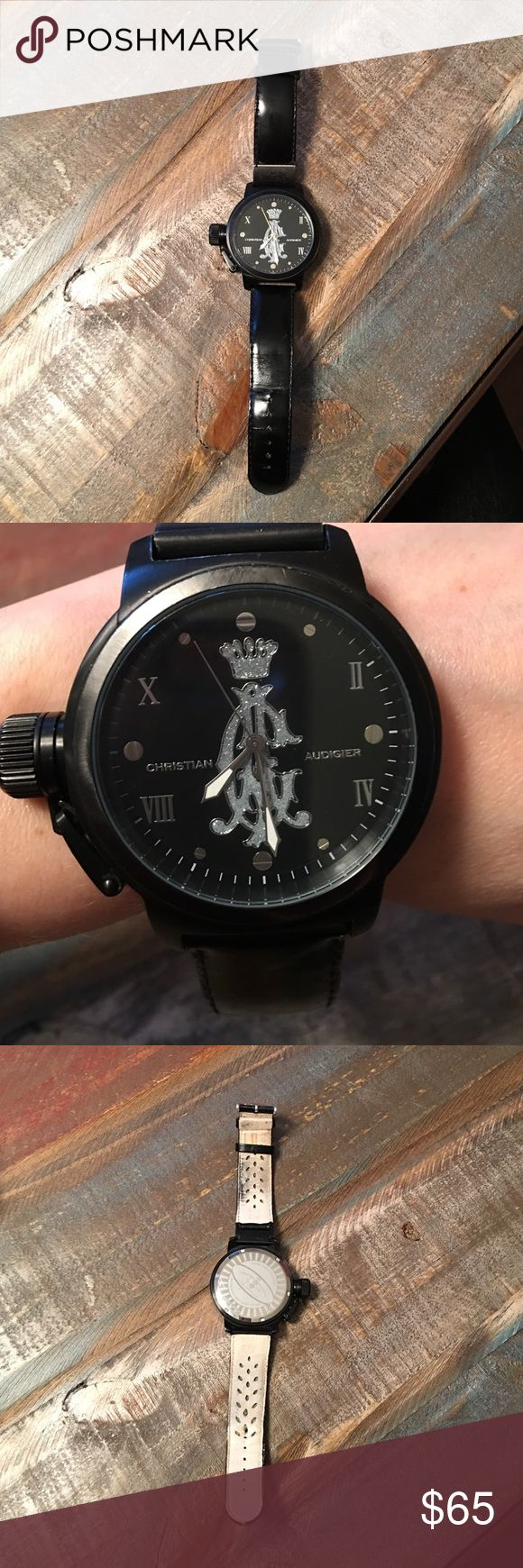 Men's black Christian Audigier Watch The Christian Audigier Eternity Black Metal Ion Plating Watch is stylish and sleek. The polished silver-tone hands have luminous accents, making this timepiece easy-to-read day or night. Water resistant up to 165 ft. Model No ETE-117. Glass face is in great condition, but there are scratches around the side, and the back is heavily scratched. Band is very worn, and it needs a battery. A great piece to add to your watch collection for everyday wear…