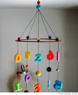 Adorable counting mobile. Perfect for your kids room. You could even make an letter mobile.   Making these shapes with some material lying around in your house or some old clothes from your baby closet would be a great idea.