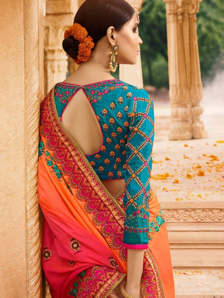 Contrasting hues put together to make a lovely designer sari! The blue and orange coloured half-and-half sari has colorful ethnic and floral patterns. A hint of pink on the pallu adds a further t...