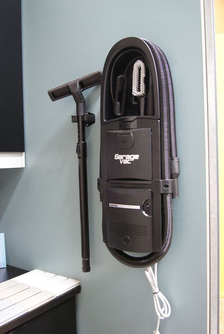 This super cool garage vacuum has a hose that stretches 40 feet!!!  mount it to the garage wall and vacuum the cars in the driveway.