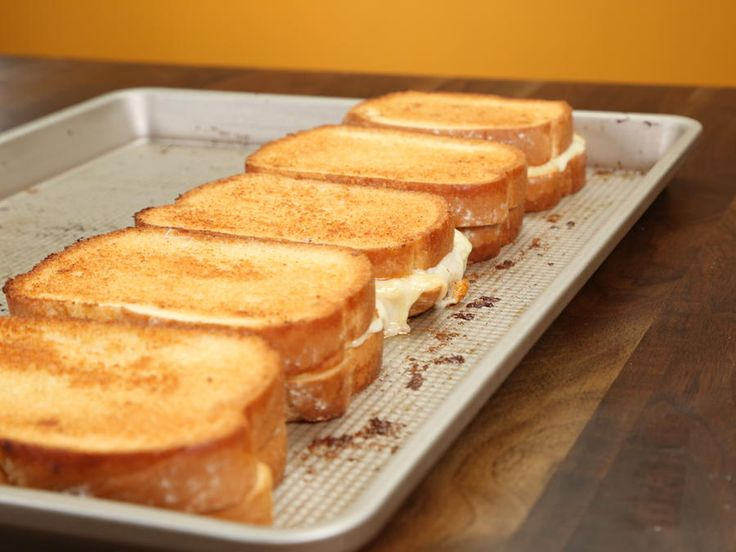 This simple sheet pan technique allows you to make five grilled cheese sandwiches with at the same time (meaning everyone around the...