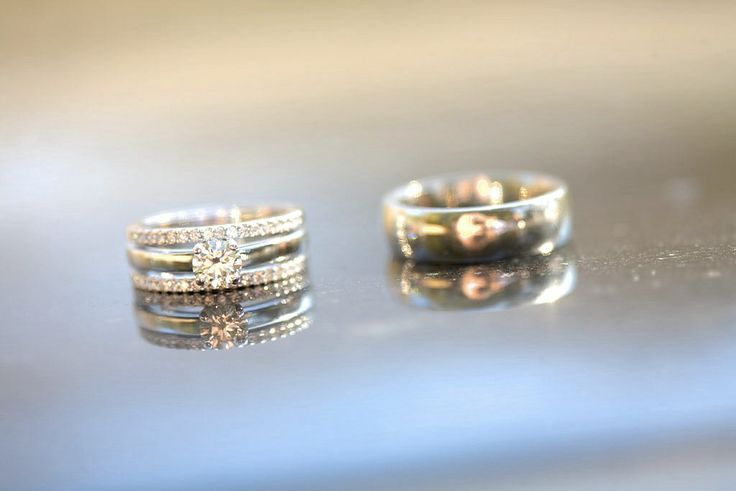 His and hers wedding rings, engagement ring is centre piece for hers with half infinity bands joined to it.