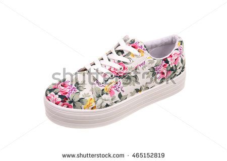 Woman shoe with floral pattern isolated on white background