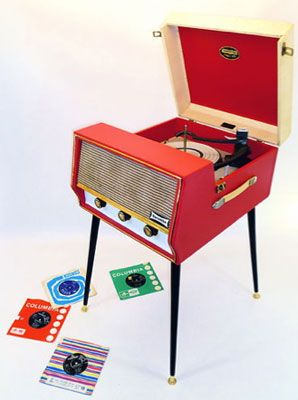 1960s Dansette Conquest record player with legs.Inside the full-serviced Dansette, you'll find a valve amplifier, a four-speed Monarch deck autochanger (16, 33, 45 and 78 speeds), along with auto-play for up to right 7-inch singles.