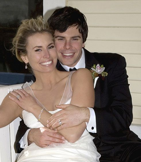 Supermodel Niki Taylor married NASCAR driver Burney Lamar on December 27, 2006 at The Grande Colonial Hotel in La Jolla, California.  The bride wore an ivory Vera Wang V-neck gown with sheer organza straps for the ceremony. Vera Wang gowns are sold at The Bridal Salon at Saks Jandel.