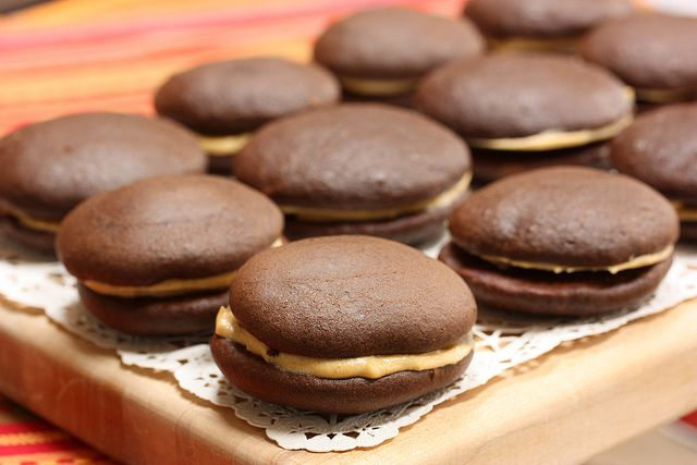 Chocolate Pumpkin Whoopie Pies -- A makeover of traditional whoopie pies without all the fat and calories thanks to light cream cheese, pumpkin puree, whole wheat flour, and expeller pressed canola oil. #dessert #pumpkin #chocolate via MealMakeoverMoms.com/kitchen