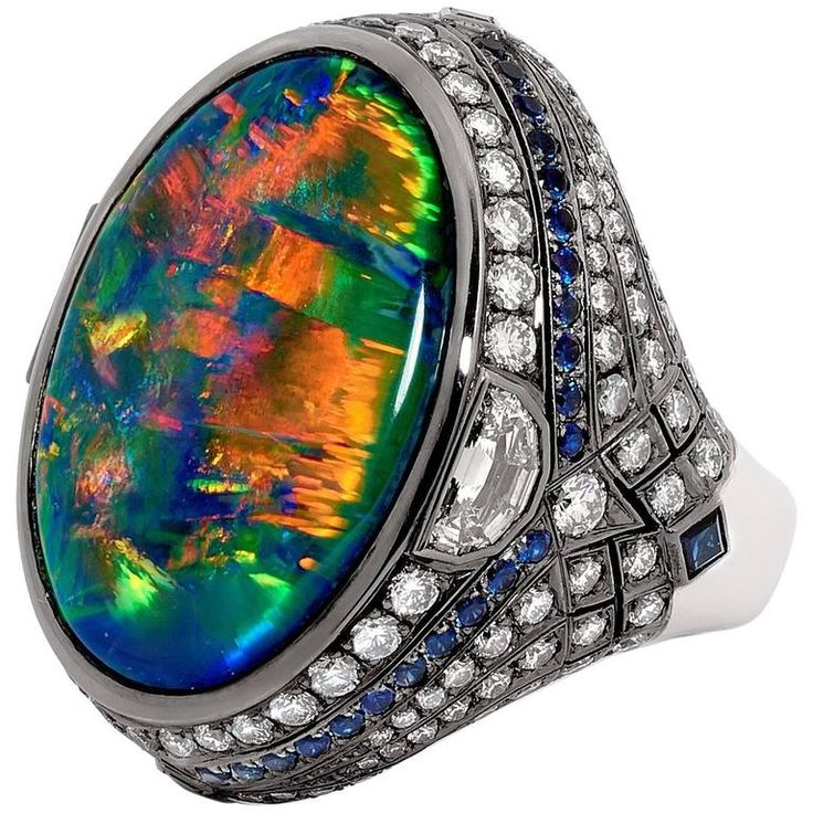 Certified 25.10 Carat Lightning Ridge Black Opal Blue Sapphire Diamond Ring | From a unique collection of vintage cocktail-rings at https://www.1stdibs.com/jewelry/rings/cocktail-rings/