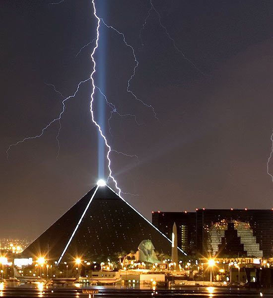 A lightning bolt strikes near the Luxor Hotel and Casino in Las Vegas, Nev., on July 17, 2006