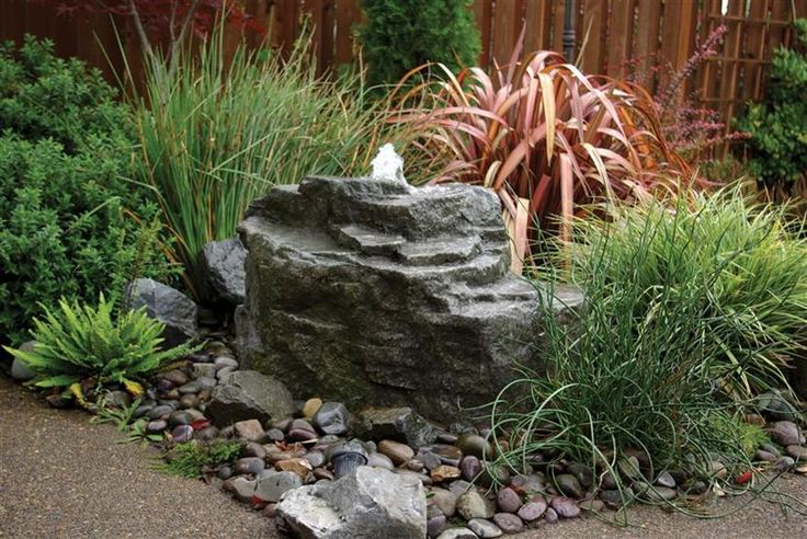 pond with rock fountain | pond less waterfalls retaining wall waterfalls bubbling rock fountains ...