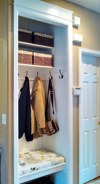 Entryway Closet Makeover -- take off the door, add a bench, hooks instead of hangers, shelving above. I'd add some drawers or bins below the bench as well for shoes