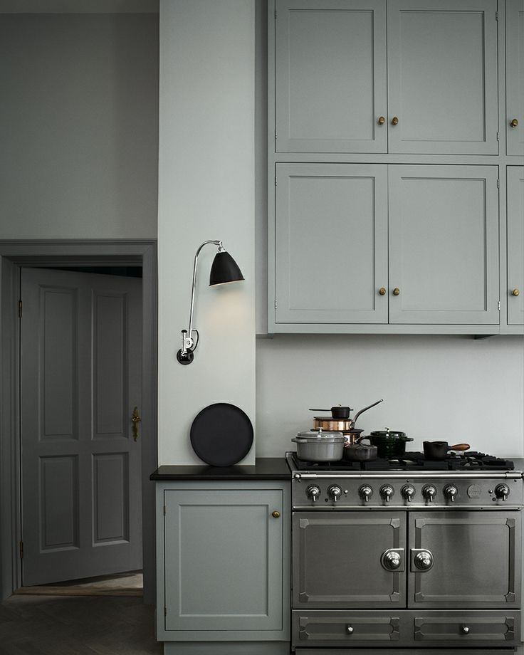beautiful, simple grey kitchen, silver/metallic range