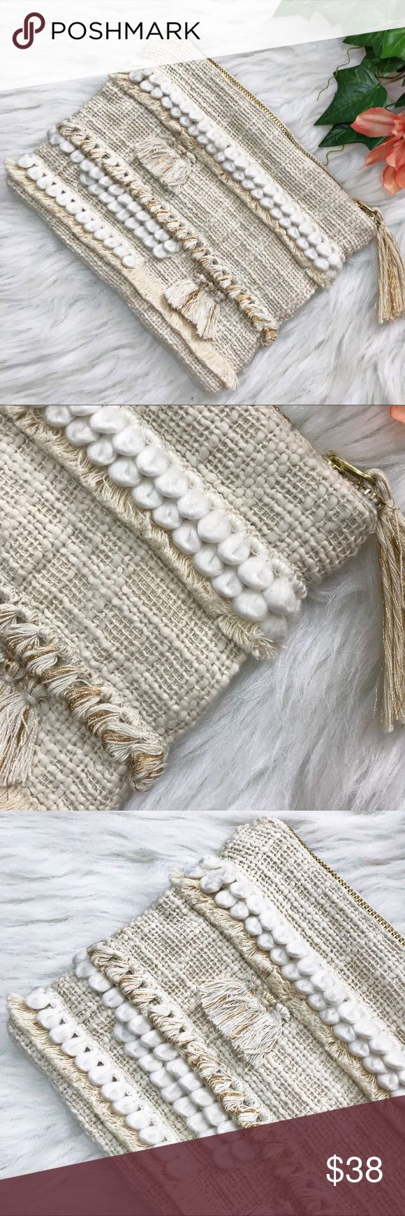 Anthropologie Woven Fringed Cotton Ball Clutch Bag Anthropologie  Woven Fringed Cotton Ball Clutch Bag . Wonderfully Woven in a Cotton Burlap Texture with White Loopy Ball Trim . Natural colored softly fringed . Gold Metallic Woven Tassels . Zip Top . The Perfect Little Clutch or use it as a beautifully luxuriant Cosmetics Bag . Size 7 Tall 9 Wide . Preloved in excellent condition . Anthroplogie Woven Cream Clutch Bag Cosmetic Bag Anthropologie Bags Clutches & Wristlets