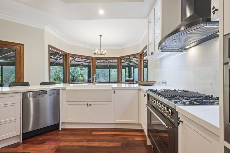 Here is our latest kitchen renovation in beautiful Yarrambat, Melbourne. Featuring a stone bench top and splash back to match, a Perrin & Rowe mixer, a fireclay sink from The English Tapware Company and stunning ILVE rangehood, steam and freestanding oven to complete the space. Electrical fittings by Beacon Lighting and Clipsal. Designed by M.J. Harris Design.