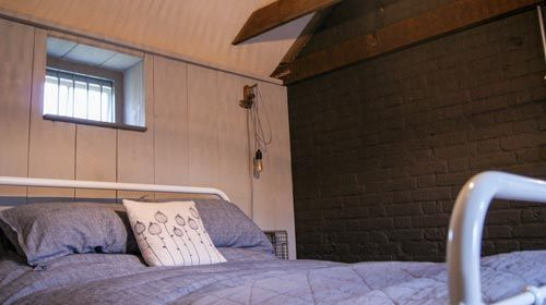 ned's nest Bedroom charcoal wall