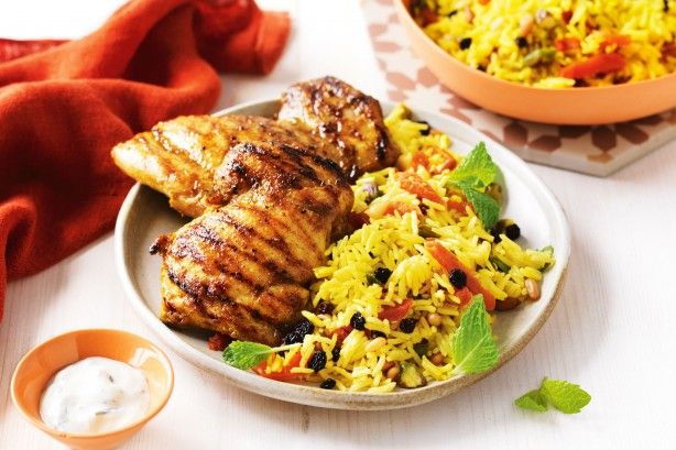 Turn on the BBQ for these easy spiced chicken thighs served with sweet and nutty Persian rice.