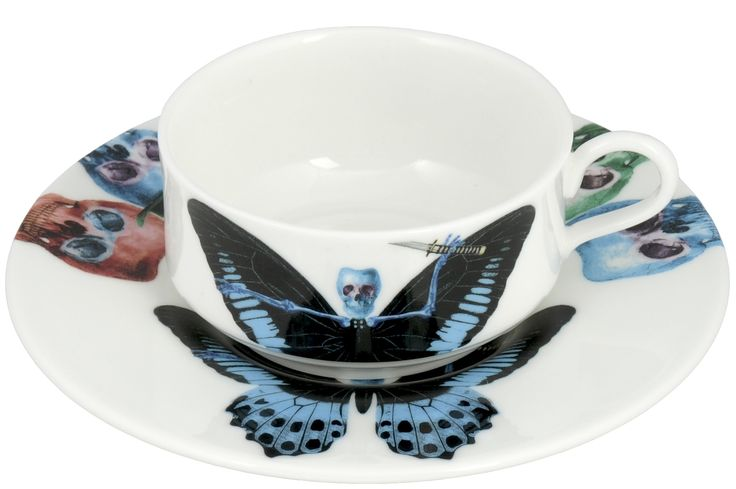 'Putulanus' Mocha Cup & Saucer taken from the 'Lepidoptera' range designed by Maxim from The Prodigy. Based on imagery drawn from his wonderful paintings, this range features an array of unusual creatures. Butterfly design on cup continues onto saucer. Saucer also features edgy skulls taken from each six designs. Rear of mocha cup features a 22kt gold butterfly detail. Fine Bone China. Made in Stoke-on-Trent, England.