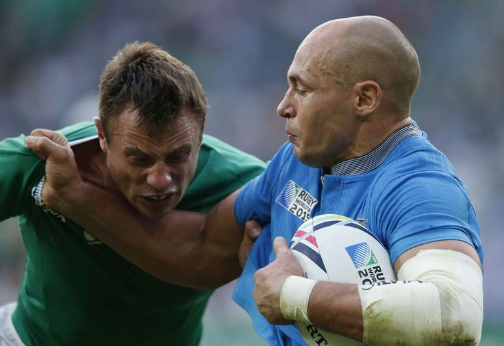Ireland's Tommy Bowe tackles Italy's captain Sergio Parisse during the Rugby World Cup Pool D match between Ireland and Italy at the Olympic Stadium, London, Sunday, Oct. 4, 2015. (AP Photo/Christophe Ena)/RUG201/288653985847/1510041849