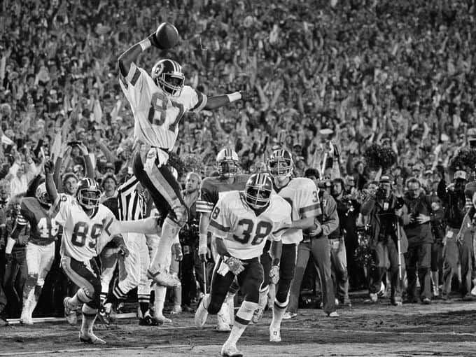 Super Bowl XVII (Redskins 27, Dolphins 17): Washington Redskins receiver Charlie Brown gets ready to spike the ball after he scored a fourth quarter touchdown.