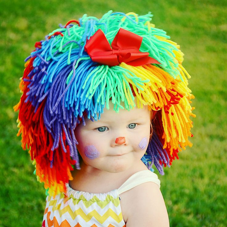 Colorful Clown Wig Halloween Costume. Wonderful photo prop or unique winter hat!  ** This listing is for the wig only. Outfit not included. **  • Handmade with 100% acrylic yarn • Removable bow • Full wig—yarn is securely woven into a snug fitting beanie that stops at the natural hairline • Shoulder length hairstyle with bangs • Stays on without pins, bands or glue • Warm and comfortable • Durable-no matter how hard baby pulls, the hair won't come out! • Doubles as a costume piece or a…