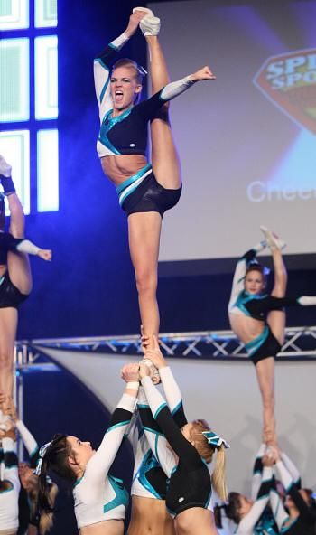 Maddie Gardner, bow and arrow, cheer, stunt, cheerleader, cheerleading  from Cheer Extreme: Maddie Gardner & Erica Englebert  board http://pinterest.com/kythoni/cheer-extreme-maddie-gardner-erica-englebert/  #KyFun