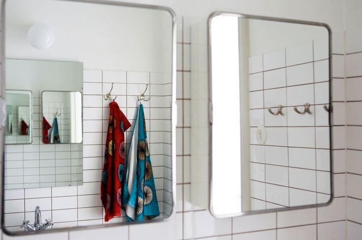 Interior with all Byggfabriken stuff: Subwaytiles, hooks, faucet, porcelain lamp and mirror cabinets: http://www.byggfabriken.com/sortiment/inredning/badrumsinredning/info/produkter/588-350-badrumsskaap-mindre/